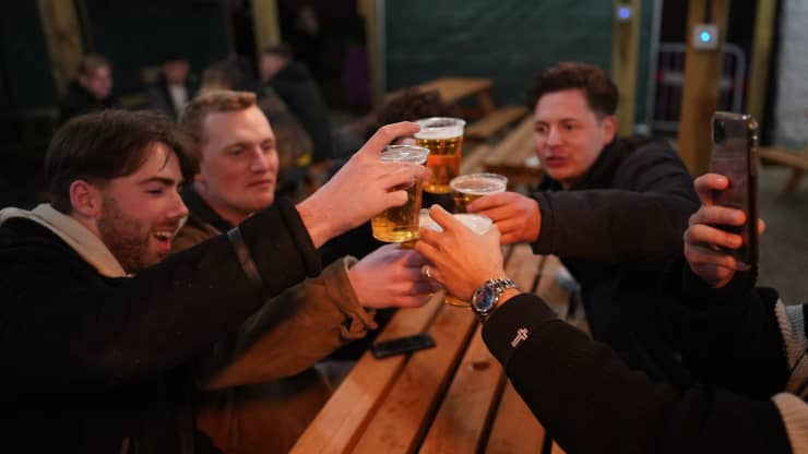 Midnight drinkers flock to Britain's beloved pubs as lockdown eases